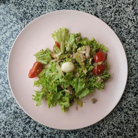 Salad mix, turkey fillet, cherry tomatoes, quail egg, caraway seeds, sauce 写真素材