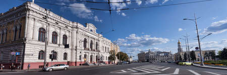 KHARKIV, UKRAINE - AUGUST 6, 2019: Constitution Square in Kharkiv. In the foreground to the left is a house built for the Land Bank in 1899 by Alexey Beketov