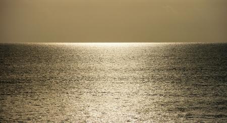 A single gold sunlight on the horizon, Lombok, Indonesia