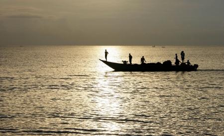 Silhouette of Lombok fishermen back from the ocean