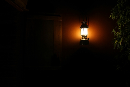 An Antique lamp hanging on the wall