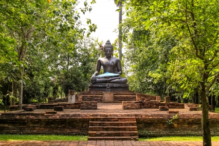 Image of Buddha in peaceful garden  Stock Photo