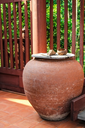 Water Jar outside traditional house  Stock Photo