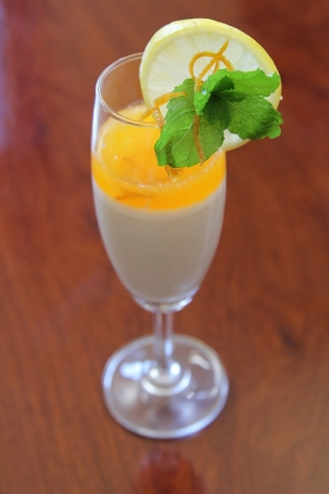 Panacotta with orange sauce in champagne glass