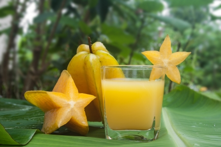 Starfruit and Starfruit juice on a banana leaf