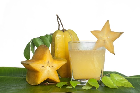 Starfruit and Starfruit juice on white background