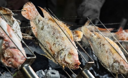 cichlidae: Fish Nile Tilapia  covered by salt grill on the stove  Stock Photo