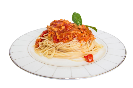Spaghetti with tomato sauce on a plate isolated on white