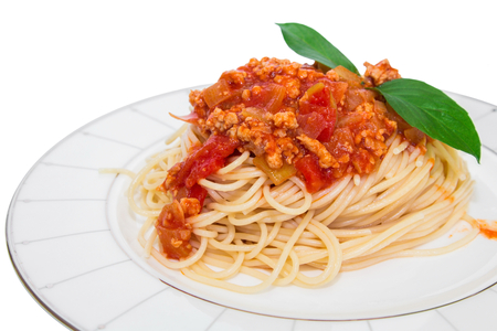 Spaghetti with tomato sauce on a plate isolated on white  photo