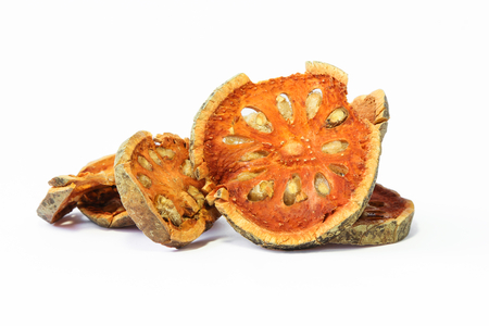 Slices of dried bael fruit on White Background.