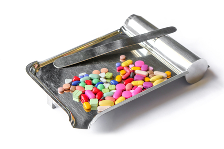 Close up of pills on Counting tray isolated on white background. Stockfoto