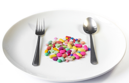 Drugs on a dish with spoon and fork