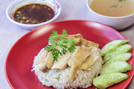 oiled: Hainanese Chicken Rice with sauce and soup, oiled rice with steamed chicken Stock Photo