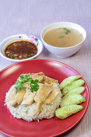 Hainanese Chicken Rice with sauce and soup. Stock Photo
