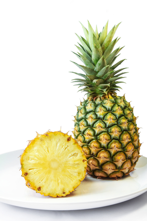 Pineapple with slices on a white dish, Fruit.