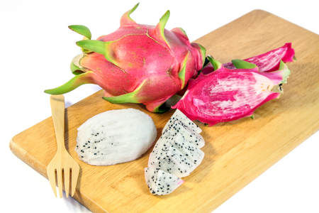 trencher: Slices Dragon Fruit on a wooden trencher