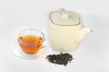 White teapot, a cup of Oolong tea and dried tea leaf, chinese traditional. Stock Photo