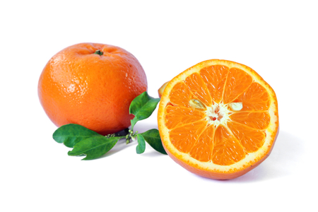 Half of orange fruit with leaf and orange on white background, citrus fruit. Stock Photo