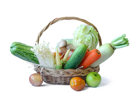 Fresh fruits and vegetables on a wooden basket isolated on white background, food ingredient, plant. Stock Photo