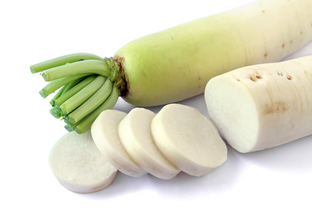 Fresh white radish root with slices on white background, vegetable, food. Stock Photo