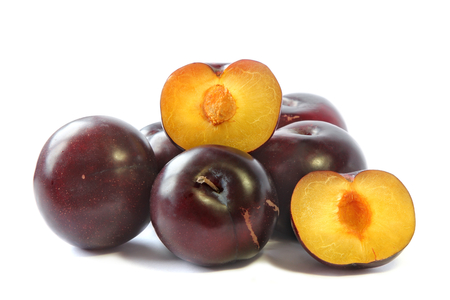 Ripe Plums and slices isolated on white background, fruit.