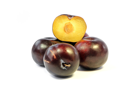 Plum and half of plum on  white background Stock Photo