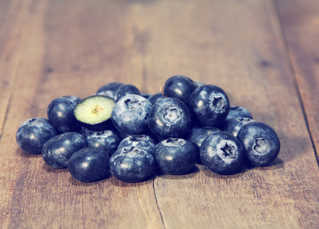 Group of fresh blueberry on wooden background, fruit.