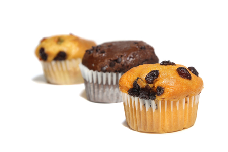 Raisin muffin, chocolate muffin and mix fruit muffin on white background. food, bakery,dessert. Stock Photo