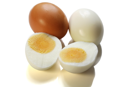 Chicken boiled egg and brown egg with shell isolated on white background. Stockfoto