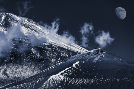 The snow mountain and the moon. Mount Fuji.