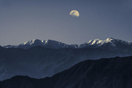 The snow mountain and the moon. Landscape scenario from Fuji mountain.