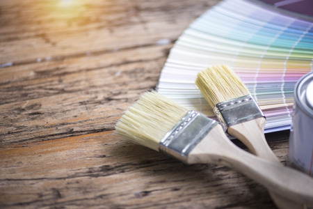Paint brush and can color on wooden table, Creative DIY Concept