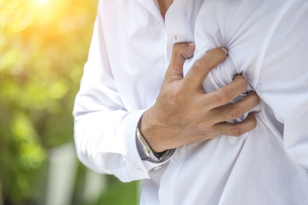 Middle-aged man holding his chest, Patients with heart disease