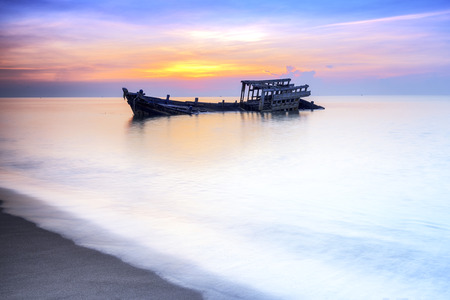 Seascape photography, Old shipwreck or abandoned shipwreck, Wrecked boat abandoned stand on beach.