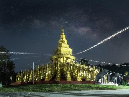 Night Photography, Background blur Milky Way with Buddha Thai Pagoda (Long Exposure) Stock Photo