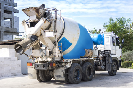 Construction Industrial Concept, Cement mixer truck with precast concrete piles at building construction site