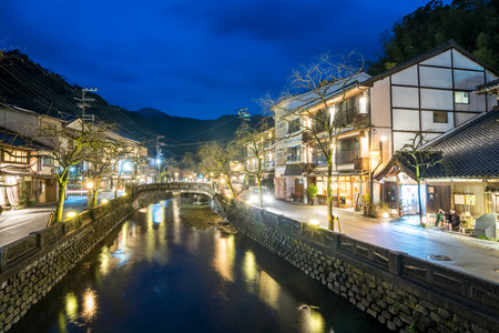 The river and ancient stone bridge in Kinosaki Onsen Hyogo Province, Japan.