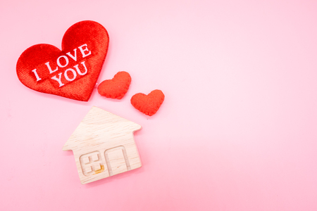 Small wooden house and red heart with wording