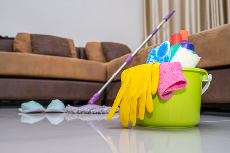 Cleaning service concept, Bucket with sponges and mopping stick. Washcloth and towel. Household equipment. Standard-Bild