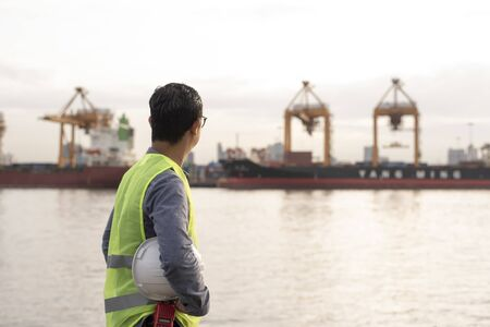 Rear of logistic engineer looking at cargo shipping port Standard-Bild