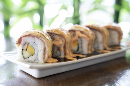 Five pice salmon burn roll on the japanese dish