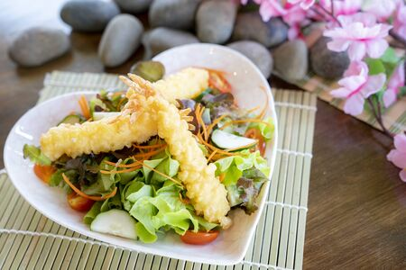 Salad vegetable with shrimp tempura in Japanese traditional dish