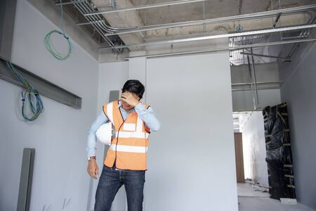 Engineer Disappointed and stressed standing in the construction site
