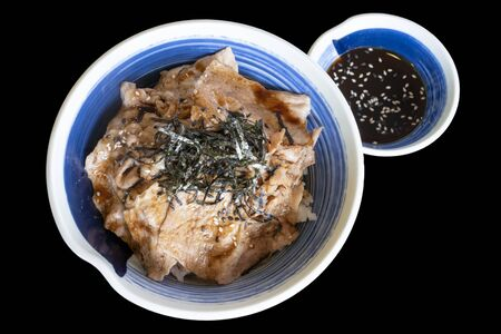 Rice with Shabu pork topping with seaweed in Japanese bowl on black color background