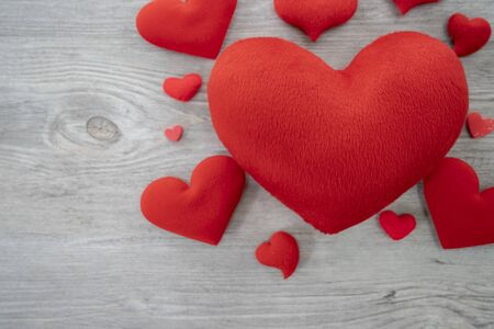 Many red heart on the table with empty space, Selective focus