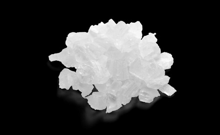 Isolated Coarse Sea Salt. Stock Photo