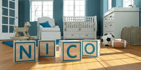 3D Illustration of the name nico written with wooden toy cubes in childrens room Imagens