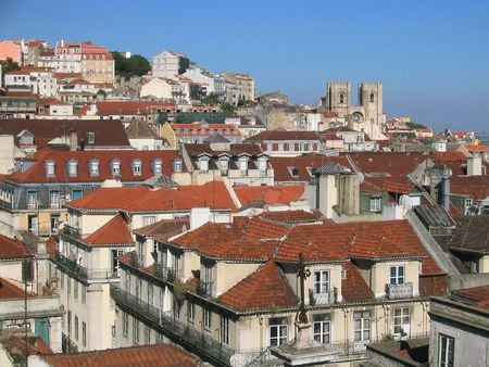 mediterrean: Mediterrean city (Lisbon) view with old houses and a church Stock Photo