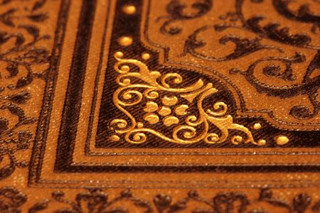 Antique bookcover (detail) with ornaments in brown and gold Stock Photo