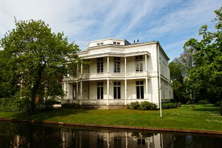 Canal with traditional mansion (City: The Hague, The Netherlands, Europe) photo